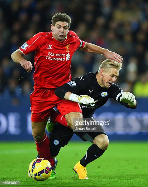 Steven Gerrard of Liverpool collides with Kasper Schmeichel of Leicester City uring the Barclays Premier League match between Leicester City and...