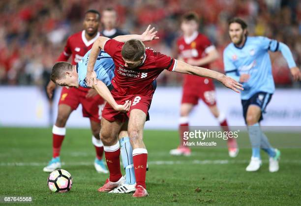 Steven Gerrard of Liverpool competes for the ball with Brandon O'Neill of Sydney FC during the International Friendly match between Sydney FC and...