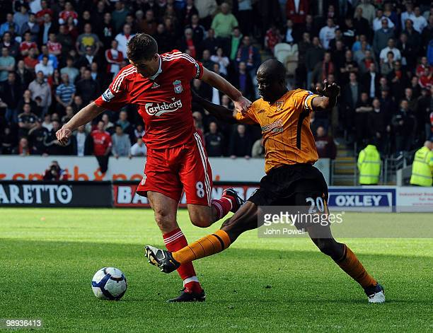 Steven Gerrard of Liverpool competes with George Boateng of Hull City during the Barclays Premier League match between Hull City and Liverpool at KC...