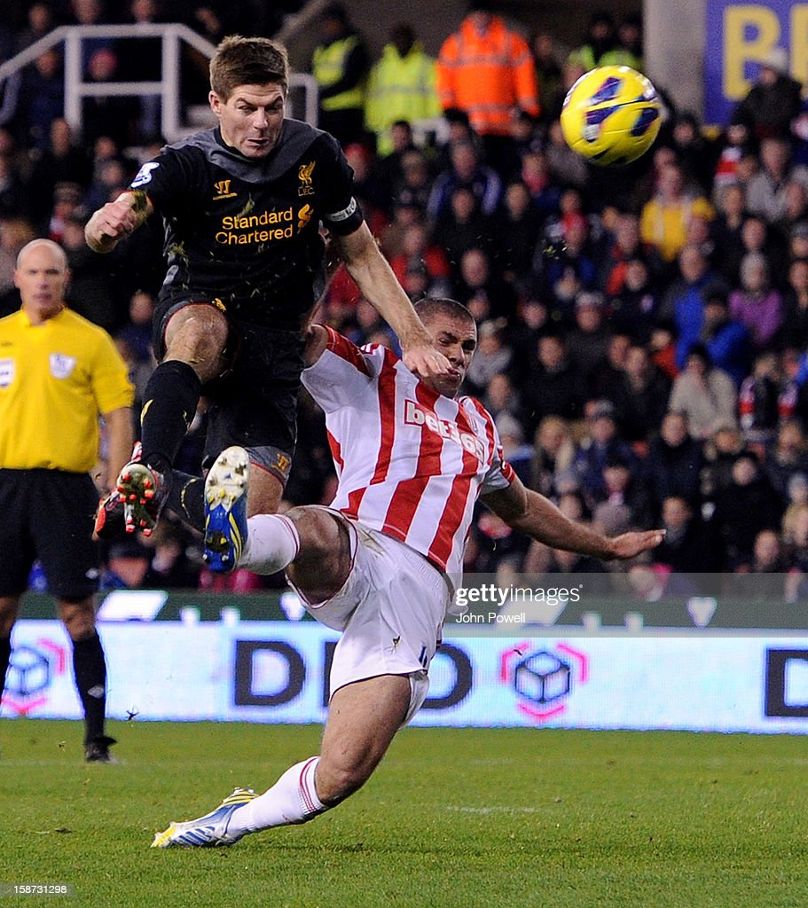 Steven Gerrard of Liverpool competes with Jonathan Walters of Stoke City during the Barclays Premier League match between Stoke City and Liverpool at Britannia Stadium on December 26, 2012 in Stoke on Trent, England.