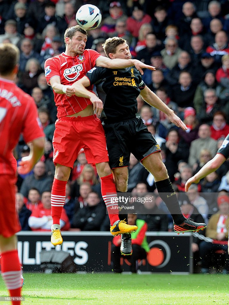 Steven Gerrard of Liverpool goes up with Morgan Schneiderlin of Southampton during the Barclays Premier League match between Southampton and Liverpool at St Mary's Stadium on March 16, 2013 in Southampton, England.