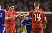Steven Gerrard of Liverpool hands the Captain's arm band over to Jordan Henderson of Liverpool during the Capital One Cup SemiFinal first leg match...