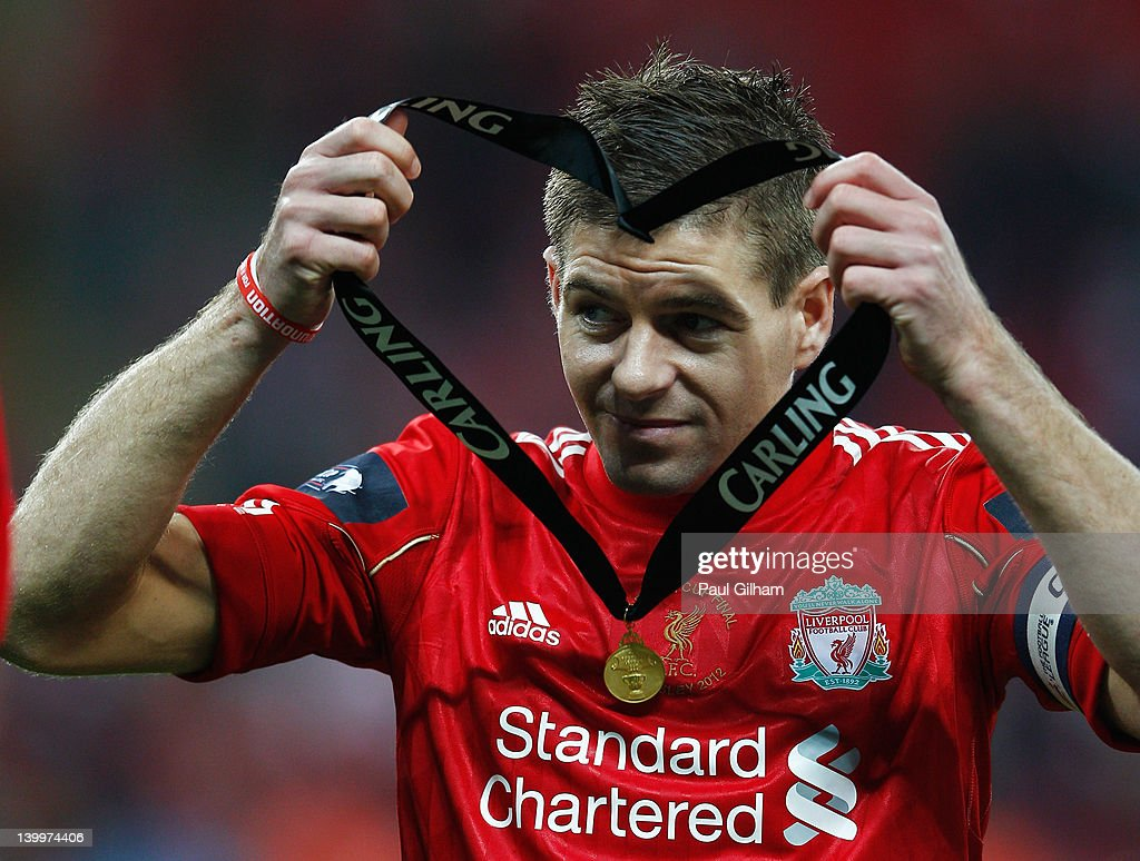 <a gi-track='captionPersonalityLinkClicked' href=/galleries/search?phrase=Steven+Gerrard&family=editorial&specificpeople=202052 ng-click='$event.stopPropagation()'>Steven Gerrard</a> of Liverpool holds his winners medal after the Carling Cup Final match between Liverpool and Cardiff City at Wembley Stadium on February 26, 2012 in London, England. Liverpool won 3-2 on penalties.