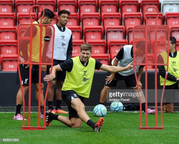 Steven Gerrard of Liverpool in action during a training session at Anfield on August 8 2014 in Liverpool England