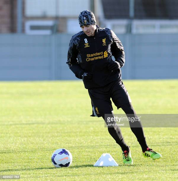 Steven Gerrard of Liverpool in action during a training session at Melwood Training Ground on December 27 2013 in Liverpool England