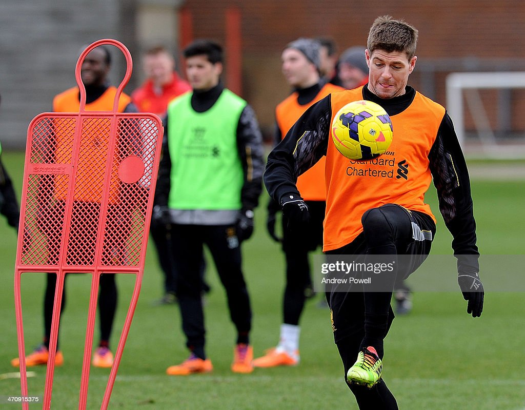 <a gi-track='captionPersonalityLinkClicked' href=/galleries/search?phrase=Steven+Gerrard&family=editorial&specificpeople=202052 ng-click='$event.stopPropagation()'>Steven Gerrard</a> of Liverpool in action during a training session at Melwood Training Ground on February 21, 2014 in Liverpool, England.