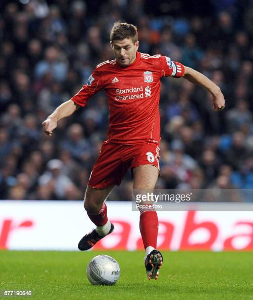 Steven Gerrard of Liverpool in action during the Carling Cup Semi Final 1st Leg match between Manchester City and Liverpool at the Etihad Stadium on...
