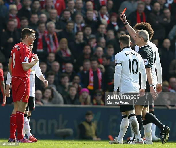 Steven Gerrard of Liverpool is sent off by referee Martin Atkinson during the Barclays Premier League match between Liverpool and Manchester United...