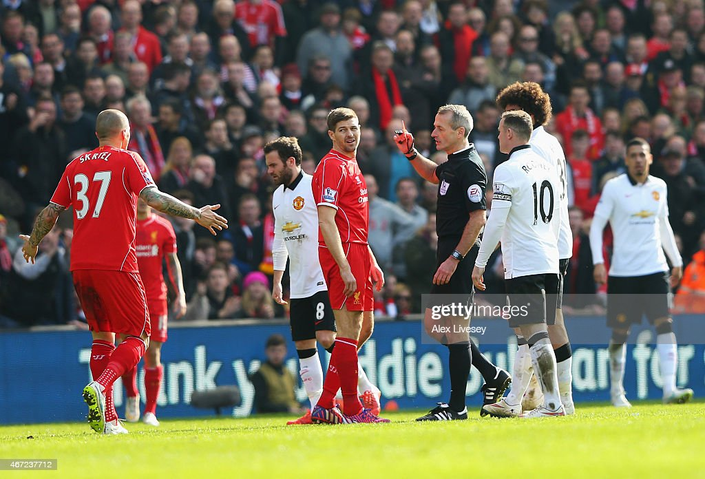 <a gi-track='captionPersonalityLinkClicked' href=/galleries/search?phrase=Steven+Gerrard&family=editorial&specificpeople=202052 ng-click='$event.stopPropagation()'>Steven Gerrard</a> of Liverpool is shown the red card by referee <a gi-track='captionPersonalityLinkClicked' href=/galleries/search?phrase=Martin+Atkinson&family=editorial&specificpeople=703318 ng-click='$event.stopPropagation()'>Martin Atkinson</a> during the Barclays Premier League match between Liverpool and Manchester United at Anfield on March 22, 2015 in Liverpool, England.