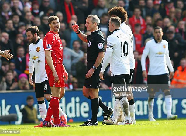 Steven Gerrard of Liverpool is shown the red card by referee Martin Atkinson during the Barclays Premier League match between Liverpool and...