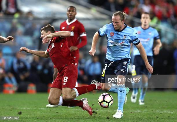 Steven Gerrard of Liverpool is tacked by Rhyan Grant of Sydney FC during the International Friendly match between Sydney FC and Liverpool FC at ANZ...