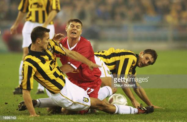Steven Gerrard of Liverpool is tackled by Marian Zeman and Evgeniy Levchenko of Vitesse Arnhem during the UEFA Cup third round first leg match held...