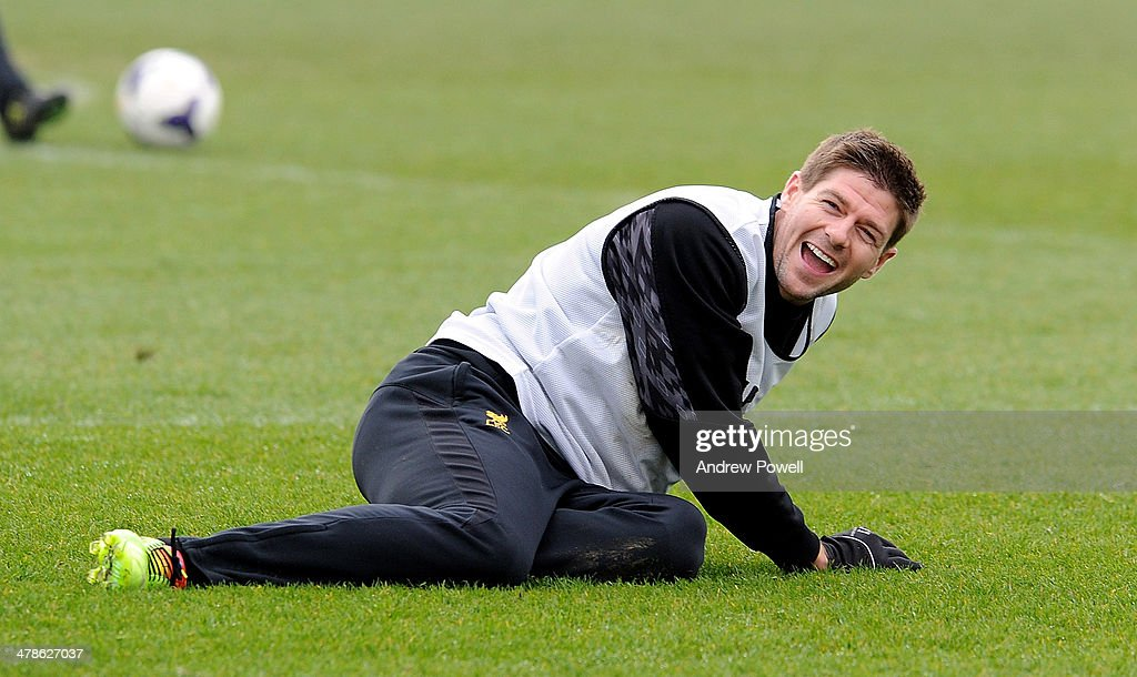 <a gi-track='captionPersonalityLinkClicked' href=/galleries/search?phrase=Steven+Gerrard&family=editorial&specificpeople=202052 ng-click='$event.stopPropagation()'>Steven Gerrard</a> of Liverpool laughing during a training session at Melwood Training Ground on March 14, 2014 in Liverpool, England.