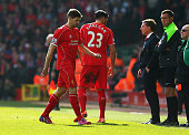 Steven Gerrard of Liverpool leaves the field after being sent off as Brendan Rodgers manager of Liverpool looks on during the Barclays Premier League...