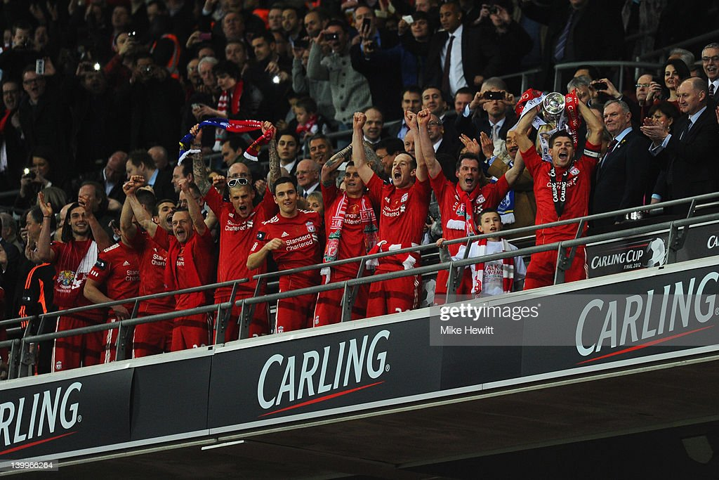 Steven Gerrard of Liverpool lifts the trophy in victory after the Carling Cup Final match between Liverpool and Cardiff City at Wembley Stadium on...