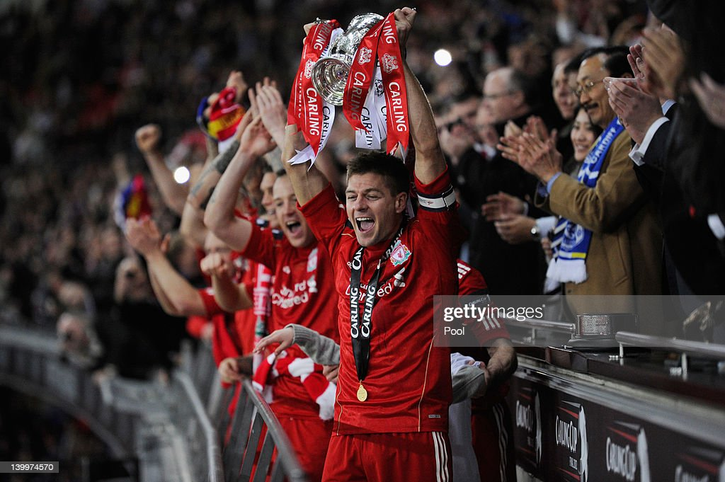 <a gi-track='captionPersonalityLinkClicked' href=/galleries/search?phrase=Steven+Gerrard&family=editorial&specificpeople=202052 ng-click='$event.stopPropagation()'>Steven Gerrard</a> of Liverpool lifts the trophy in victory after the Carling Cup Final match between Liverpool and Cardiff City at Wembley Stadium on February 26, 2012 in London, England. Liverpool won 3-2 on penalties.