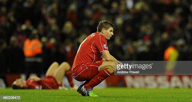 Steven Gerrard of Liverpool looks dejected at the end of the UEFA Champions League match between Liverpool FC and FC Basel 1893 on December 9 2014 in...