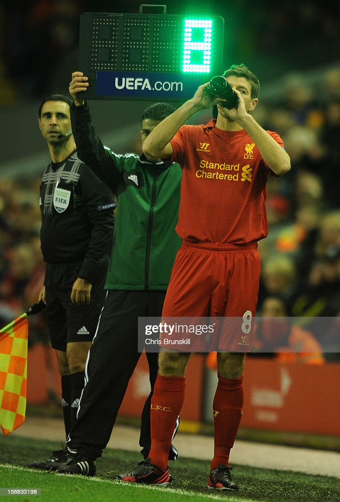 Steven Gerrard of Liverpool prepares to come on as a substitute during the UEFA Europa League Group A match between Liverpool FC and BSC Young Boys at Anfield on November 22, 2012 in Liverpool, England.
