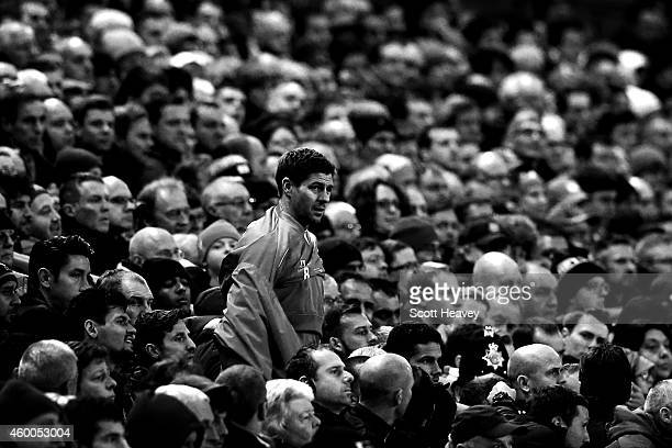Steven Gerrard of Liverpool prepares to come on to the field during the Barclays Premier League match between Liverpool and Sunderland at Anfield on...