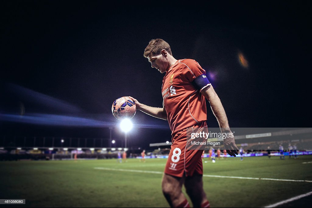 <a gi-track='captionPersonalityLinkClicked' href=/galleries/search?phrase=Steven+Gerrard&family=editorial&specificpeople=202052 ng-click='$event.stopPropagation()'>Steven Gerrard</a> of Liverpool prepares to take a corner during the FA Cup Third Round match between AFC Wimbledon and Liverpool at The Cherry Red Records Stadium on January 5, 2015 in Kingston upon Thames, England.