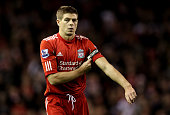 Steven Gerrard of Liverpool puts on the captain's armband during the Barclays Premier League match between Liverpool and Blackburn Rovers at Anfield...