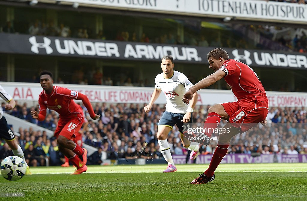 Steven Gerrard of Liverpool scores from the penalty spot during the Barclays Premier League match between Tottenham Hotspur and Liverpool at White Hart Lane on August 31, 2014 in London, England.