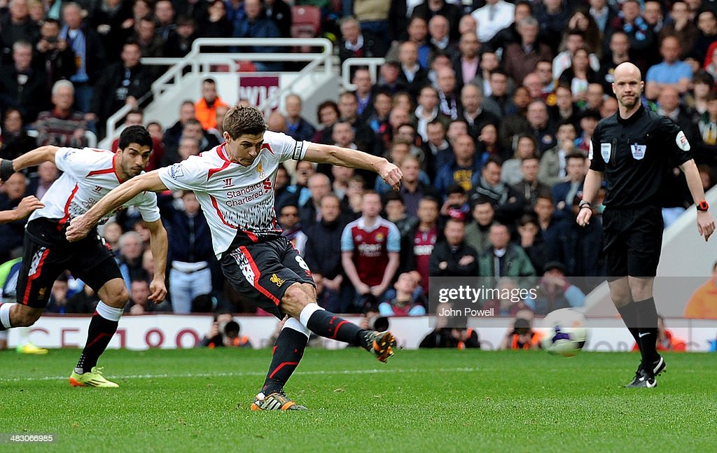Steven Gerrard of Liverpool scores from the penalty spot for the second time during the Barclays Premier League match between West Ham United and Liverpool at Boleyn Ground on April 6, 2014 in London, England.