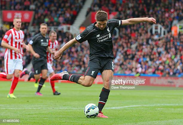 Steven Gerrard of Liverpool scores his team's first goal during the Barclays Premier League match between Stoke City and Liverpool at Britannia...