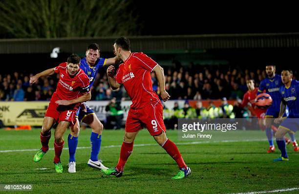 Steven Gerrard of Liverpool scores the opening goal with a header during the FA Cup Third Round match between AFC Wimbledon and Liverpool at The...