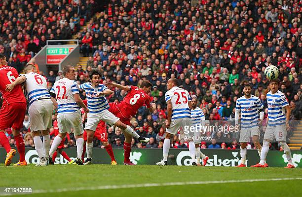 Steven Gerrard of Liverpool scores with a header during the Barclays Premier League match between Liverpool and Queens Park Rangers at Anfield on May...