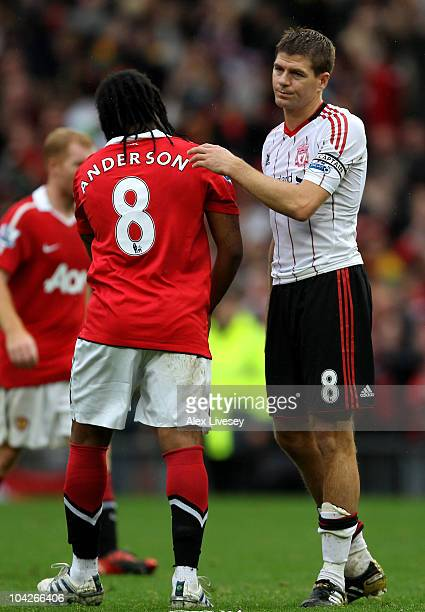 Steven Gerrard of Liverpool shakes hands with Anderson of Manchester United at the end of the Barclays Premier League match between Manchester United...