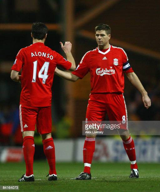 Steven Gerrard of Liverpool shakes hands with team mate Xabi Alonso prior to the FA Cup sponsored by EON Third Round match between Preston North End...