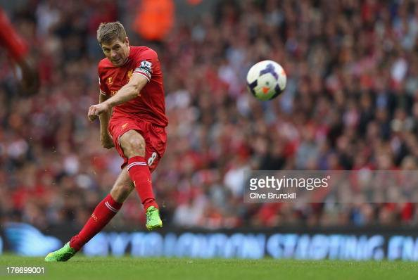 Steven Gerrard of Liverpool shoots at goal from a free kick during the Barclays Premier League match between Liverpool and Stoke City at Anfield on...