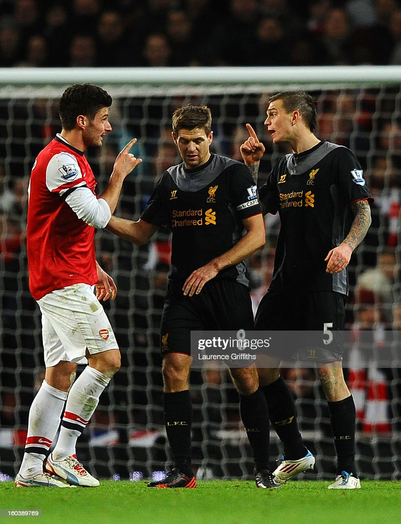 Steven Gerrard of Liverpool stands between Olivier Giroud of Arsenal and Daniel Agger of Liverpool as they have words during the Barclays Premier League match between Arsenal and Liverpool at Emirates Stadium on January 30, 2013 in London, England.