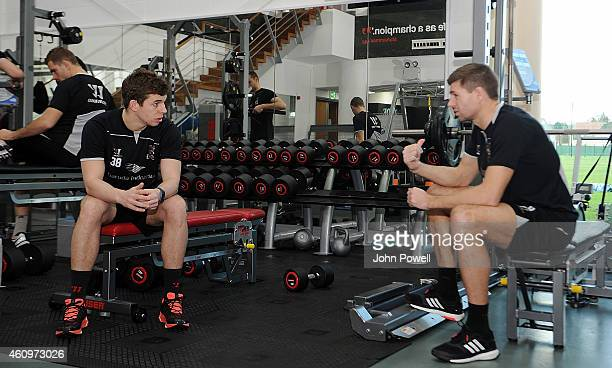 Steven Gerrard of Liverpool talks with Jon Flanagan during a training session at Melwood Training Ground on January 2 2015 in Liverpool England