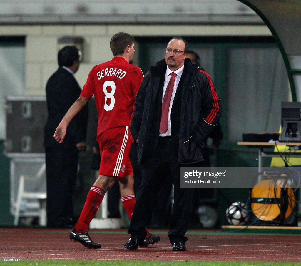 <a gi-track='captionPersonalityLinkClicked' href=/galleries/search?phrase=Steven+Gerrard&family=editorial&specificpeople=202052 ng-click='$event.stopPropagation()'>Steven Gerrard</a> of Liverpool walks past Manager Rafael Benitez as he is substituted during the UEFA Champions League group E match between Debrecen and Liverpool at the Ferenc Puskas Stadium on November 24, 2009 in Budapest, Hungary.