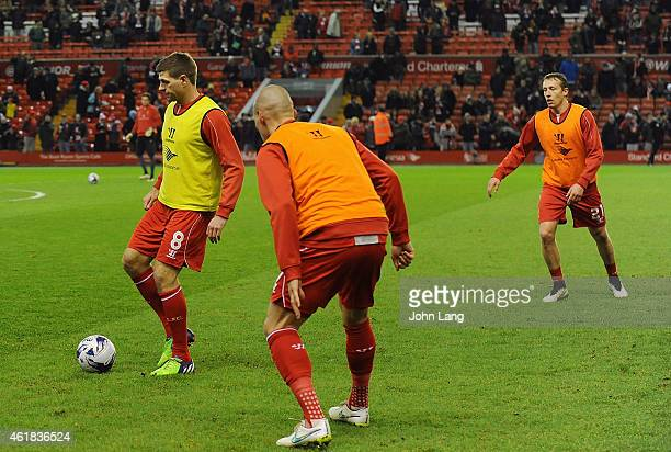 Steven Gerrard of Liverpool warms up in the passing drills before the Capital One Cup SemiFinal First Leg between Liverpool and Chelsea at Anfield on...