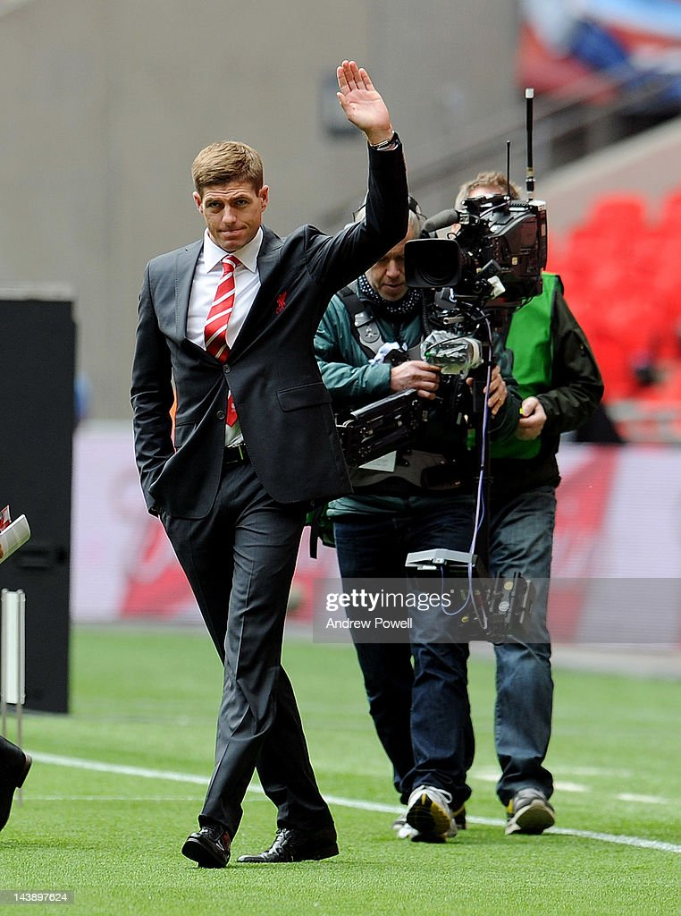 Steven Gerrard of Liverpool waves to fans in his new club suit ahead of the FA Cup Final match between Chelsea and Liverpool at Wembley Stadium on May 5, 2012 in London, England.