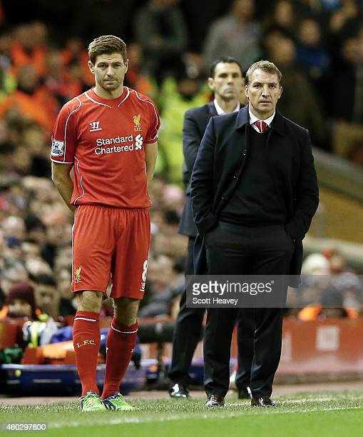 Steven Gerrard of Liverpool with manager Brendan Rogers during the Barclays Premier League match between Liverpool and Sunderland at Anfield on...