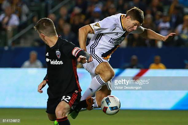 Steven Gerrard of Los Angeles Galaxy and Bobby Boswell of DC United vie for the ball during the second half of their MLS match at StubHub Center on...