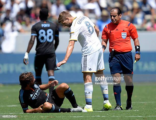 Steven Gerrard of Los Angeles Galaxy apologizes to Andrea Pirlo of New York City FC after fouling him during the first half at StubHub Center August...