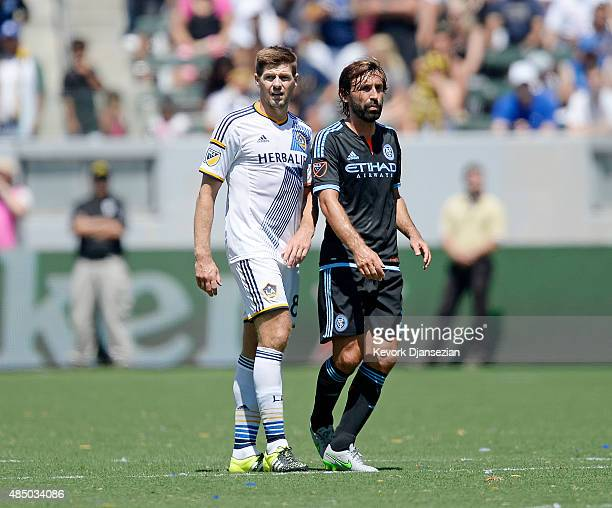Steven Gerrard of Los Angeles Galaxy bumps Andrea Pirlo of New York City FC during the second half at StubHub Center August 23 in Carson California