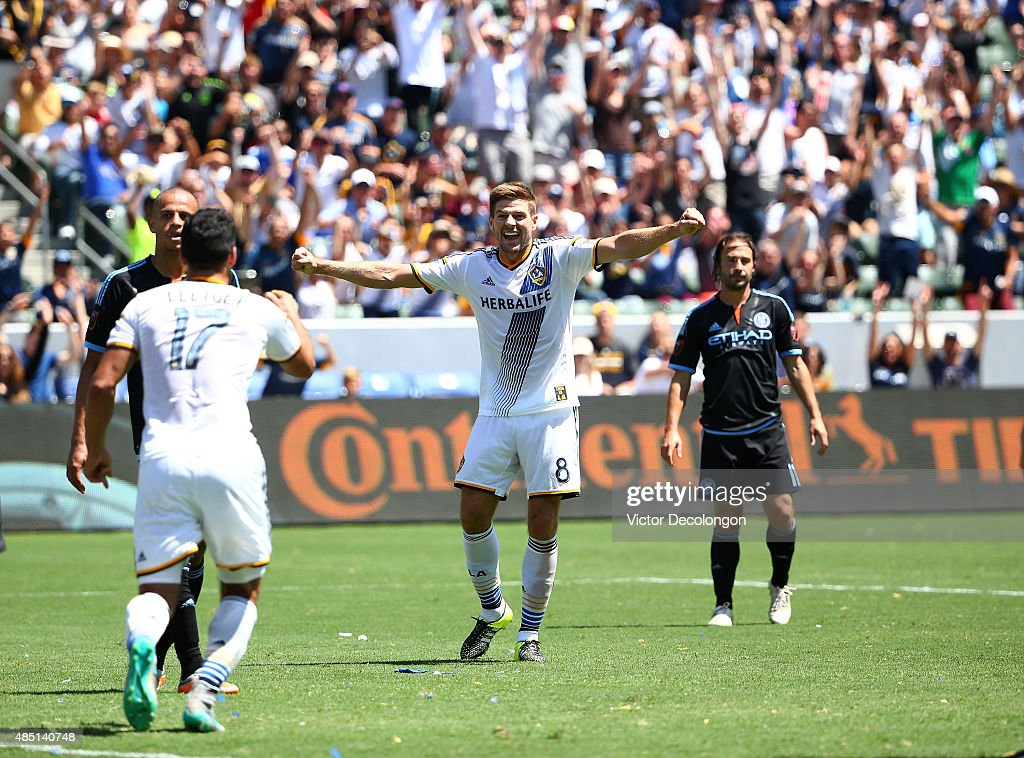 <a gi-track='captionPersonalityLinkClicked' href=/galleries/search?phrase=Steven+Gerrard&family=editorial&specificpeople=202052 ng-click='$event.stopPropagation()'>Steven Gerrard</a> #8 of Los Angeles Galaxy reacts to a goal by teammate Sebastian Lletget #17 as <a gi-track='captionPersonalityLinkClicked' href=/galleries/search?phrase=Jason+Hernandez+-+American+Soccer+Player&family=editorial&specificpeople=9684404 ng-click='$event.stopPropagation()'>Jason Hernandez</a> #2 and Ned Grabavoy #11 of New York City FC look on in the second half during their MLS match at StubHub Center on August 23, 2015 in Los Angeles, California. The Galaxy defeated NYCFC