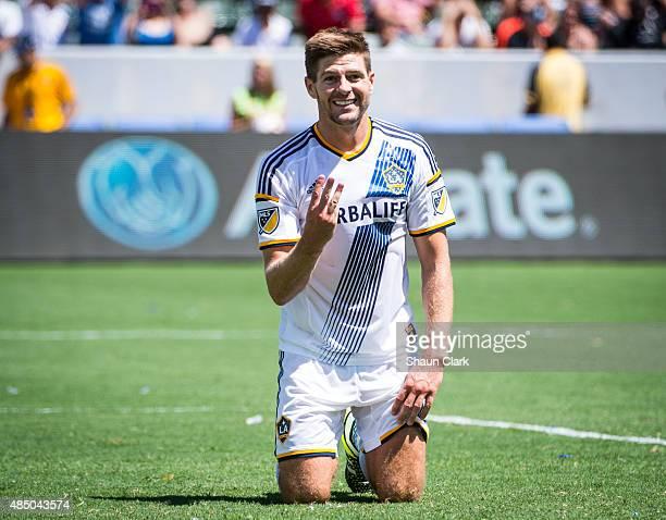 Steven Gerrard of Los Angeles Galaxy signals to Robbie Keane that Keane should have taken a shot to get a hat trick during Los Angeles Galaxy's MLS...