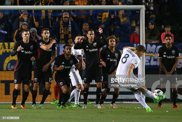 Steven Gerrard of Los Angeles Galaxy takes a direct free kick against DC United in the first half during their MLS match at StubHub Center on March 6...