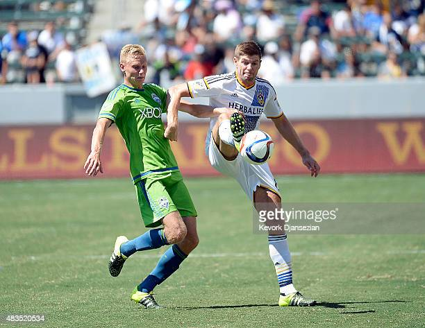 Steven Gerrard of the Los Angeles Galaxy controls the ball against Andy Rose of the Seattle Sounders during the second half of the MLS soccer match...