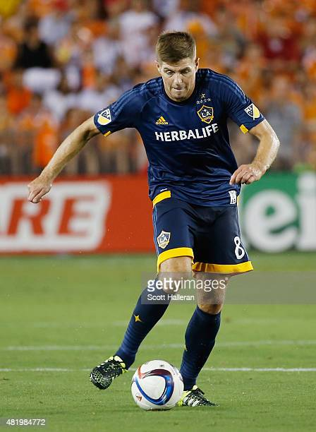Steven Gerrard of the Los Angeles Galaxy dribbles the ball during their game against the Houston Dynamo at BBVA Compass Stadium on July 25 2015 in...