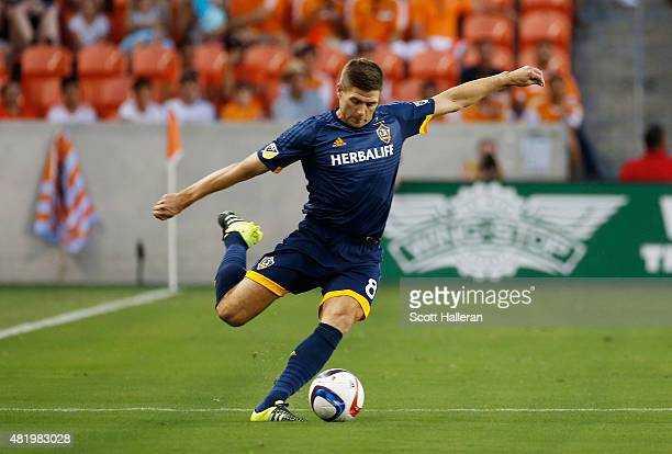 Steven Gerrard of the Los Angeles Galaxy passes the ball during their game against the Houston Dynamo at BBVA Compass Stadium on July 25 2015 in...