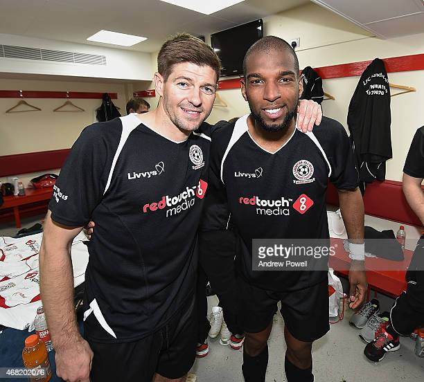 Steven Gerrard poses for a photo with Ryan Babel during the Liverpool All Star Charity Match at Anfield on March 29 2015 in Liverpool England
