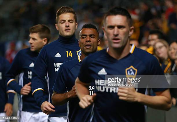 Steven Gerrard Robbie Rogers Ashley Cole and Robbie Keane of Los Angeles Galaxy warm up prior to their MLS match against DC United at StubHub Center...